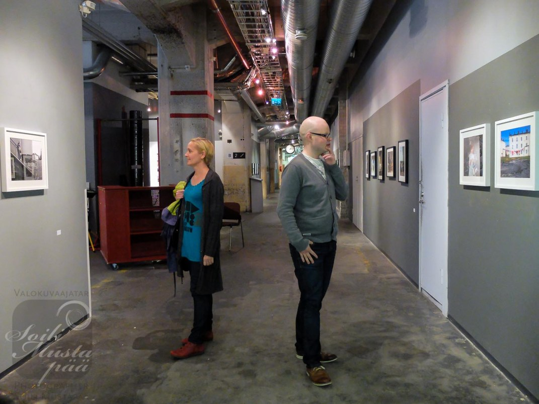 """Visitors in front of my Works @ Photography Exhibition """"The City of Man"""" at Jukka Male Museum, Cable Factory, Helsinki."""